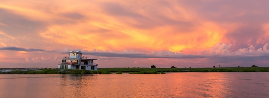 Botswana luxury houseboat at sunset