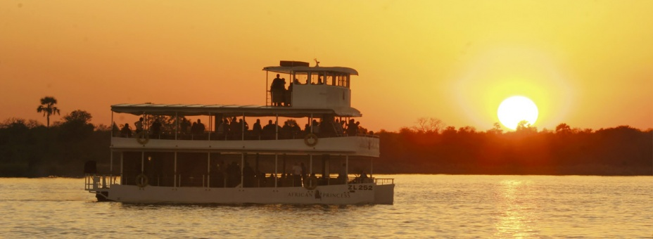 Watch the sunset from the African Princess river boat