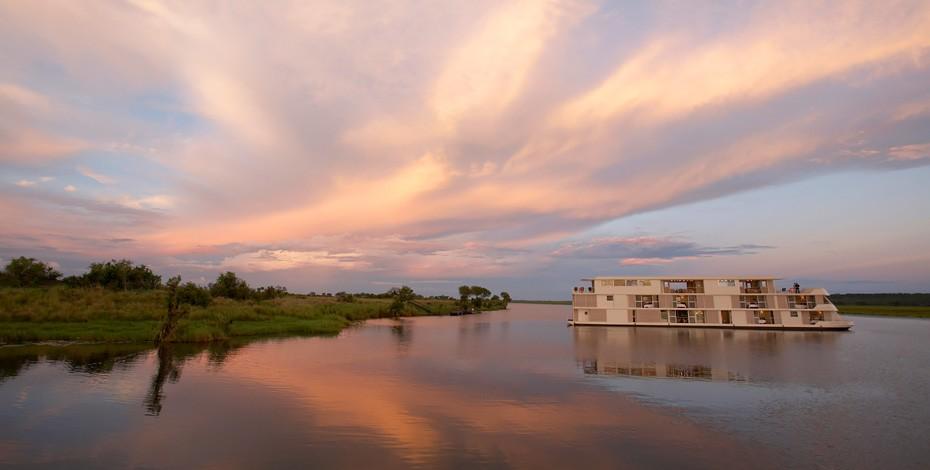 Sun setting behind the Zambezi Queen