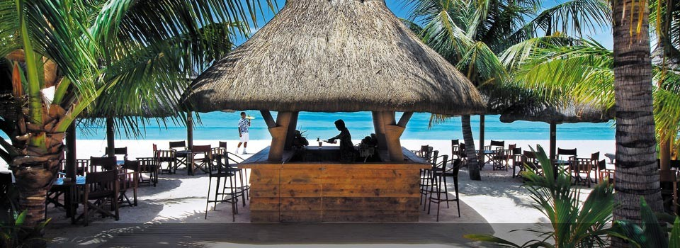 Enjoy a Drink at the Dinarobin Hotel & Spa Beach Bar