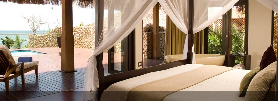 Style and comfort in the bedrooms at Indigo Bay Island resort