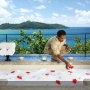 Unwind in a warm bath while soaking up the view from the Maia Luxury Resort