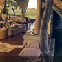 Relax in the Lounge at Singita Boulders Camp
